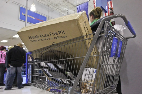 <p><p>Lauren Smith attempts to buy a fire pit for her husband but finds out from the cashier that it has been recalled. (Kimberly Paynter/for NewsWorks)</p></p>