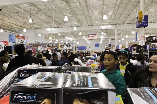 <p><p>Shoppers wait along a center aisle of bedding for 8 p.m. when the deals begin. (Kimberly Paynter/for NewsWorks)</p></p>