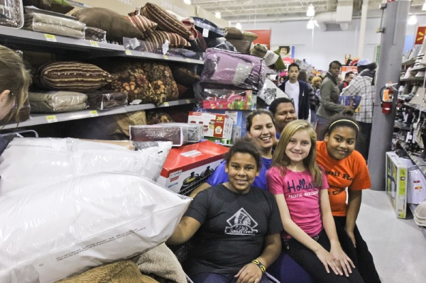 "<p><p>Danielle Dussinger, her son, daughters and niece come to Walmart every Thanksgiving, have a blast and ""get to stay up late."" (Kimberly Paynter/for NewsWorks)</p></p>"