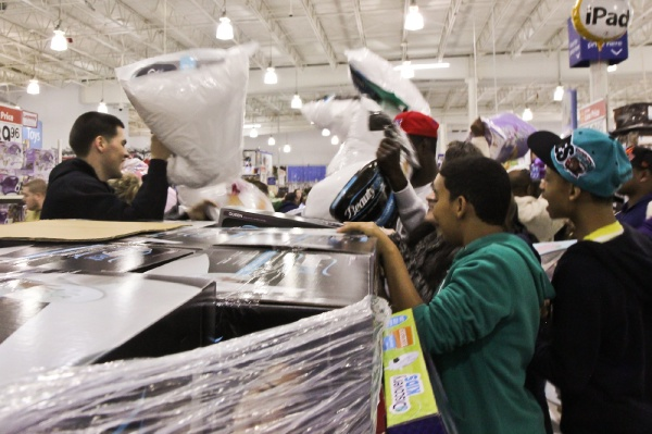 <p><p>At 8 p.m. employees all over the Walmart release the merchandise by signaling to frenzied shoppers. (Kimberly Paynter/for NewsWorks)</p></p>
