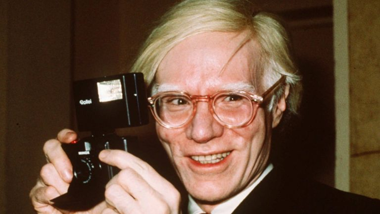 Pop artist Andy Warhol smiles in New York in this 1976 file photo. (AP Photo/Richard Drew, file)