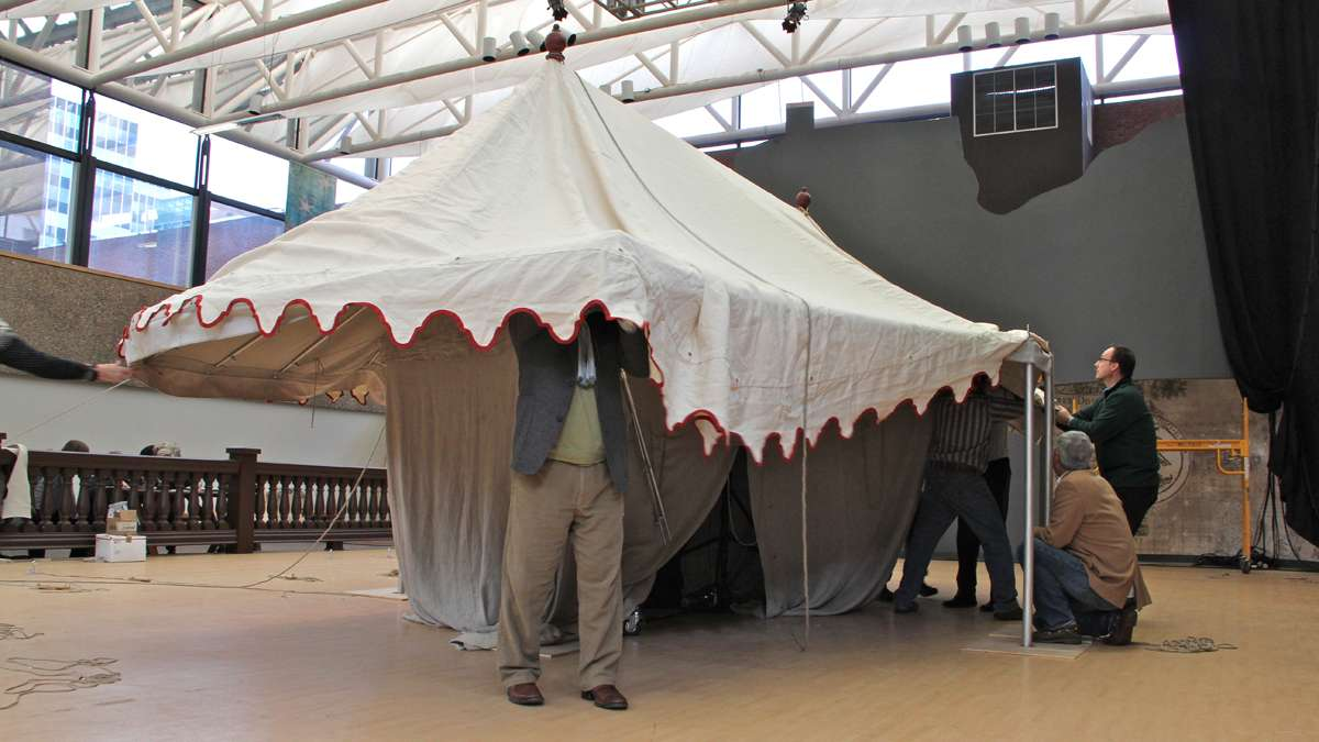 Workers assamble a replica of George Washington's command tent at the Museum of the American Revolution, in preparation for displaying the real thing. (Emma Lee/for NewsWorks)