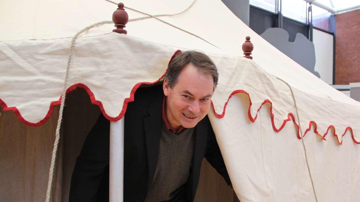 Museum of the American Revolution Project Director Scott Stephenson stoops under the entrance to a reproduction of George Washington's command tent. At 6-foot-4, Stephenson is just an inch taller than Washington was. (Emma Lee/for NewsWorks)