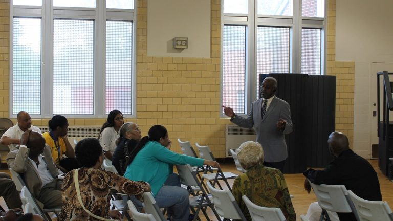 Anthony Murphy, executive director of the city's Town Watch Integrated Services, speaks with East Germantown residents in the wake of an alleged serial rapist's arrest. (Matthew Grady/for NewsWorks)