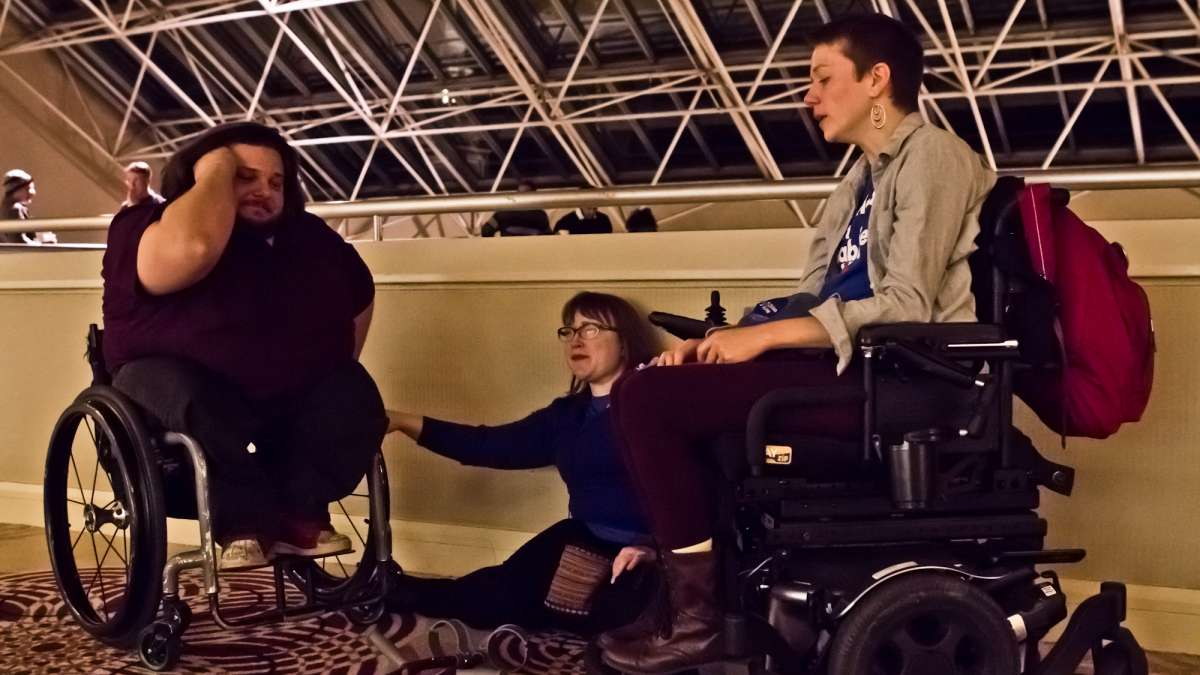 Disability rights advocates (from left) Matthew Clark, Laura Cohen, and Dynah Haubert left the Pennsylvania Democrats watch party as Donald Trump began to claim most of the states in the race.