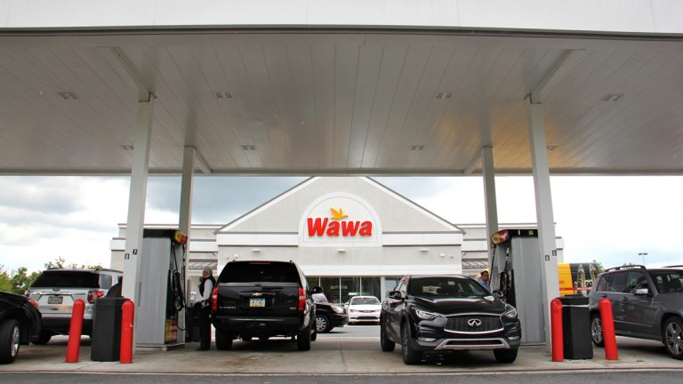 Customers fuel up at the Wawa on Bartram Avenue in Southwest Philadelphia, Pa. (Emma Lee/WHYY)