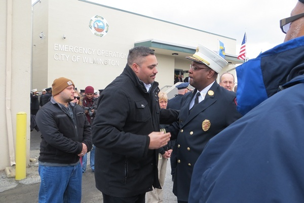<p><p>Incoming Chief of Fire, Anthony Goode, and outgoing Chief Willie Patrick shake hands (Shirley Min/WHYY)</p></p>