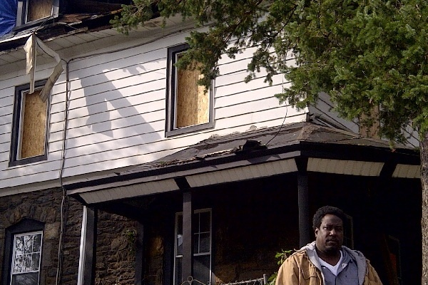 <p>&lt;p&gt;Ben Folk stood outside his family's East Oak Lane home days after it was gutted when Hurricane Sandy's outer bands sparked a blaze on Independence Street. (Brian Hickey/WHYY)&lt;/p&gt;</p>