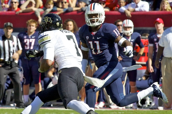<p><p>Parks (No. 11 in blue) played approximately 200 snaps this season on defense on special teams as a true freshman, including this oen against the University of Colorado. (Courtesy of Arizona Athletics)</p></p>