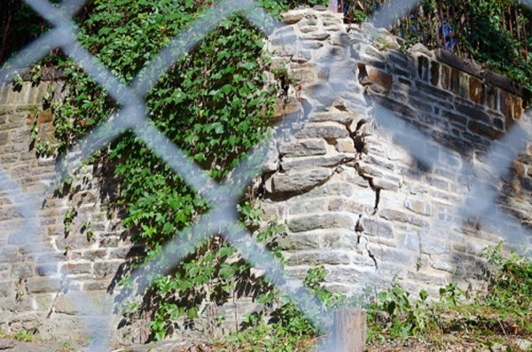 <p>&lt;p&gt;East Falls residents have expressed concern about a crumbling wall on the busy Midvale Avenue. The School District, which owns the property, is having trouble finding the funds to pay for repairs. (Bas Slabbers/for NewsWorks)&lt;/p&gt;</p>