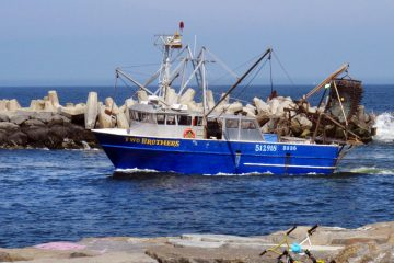 A commercial scallop fishing boat enters the Manasquan Inlet in Point Pleasant, N.J.  (Wayne Parry/AP Photo, File)