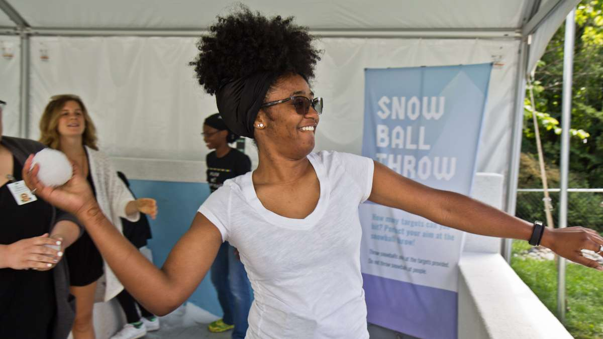 Janet Rhone throws a snowball at the target at the Winter exhibit.