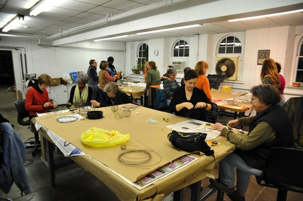<p><p>Artists and volunteers pack the room at Cheltenham center for the Arts, where they make wire vessels which will be featured in a year-long installation called One Year. (Anna Flint/for NewsWorks)</p></p>