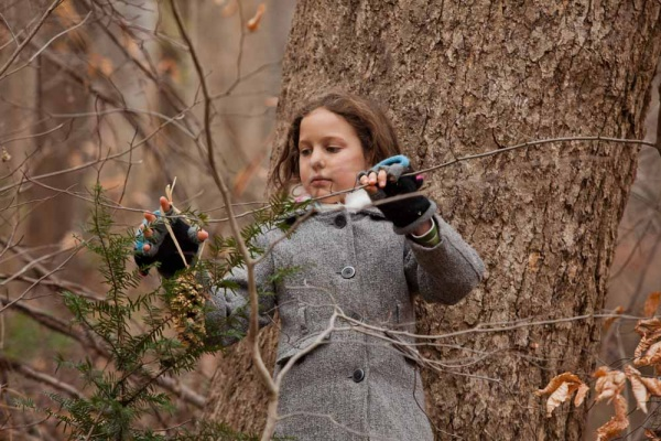 <p><p>Emma Detwiler, 9, of Chestnut Hill hangs a treat for an animal in a tree just off the Forbidden Drive at the Winter in the Wissahickon event hosted by the Friends of the Wissahickon. (Dave Tavani/for NewsWorks)</p></p>