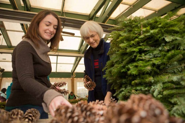 <p><p>Kathleen Hennessy of Ardmore and Cathy Fasy of Chestnut Hill select pine cones for their wreaths. (Dave Tavani/for NewsWorks)</p></p>