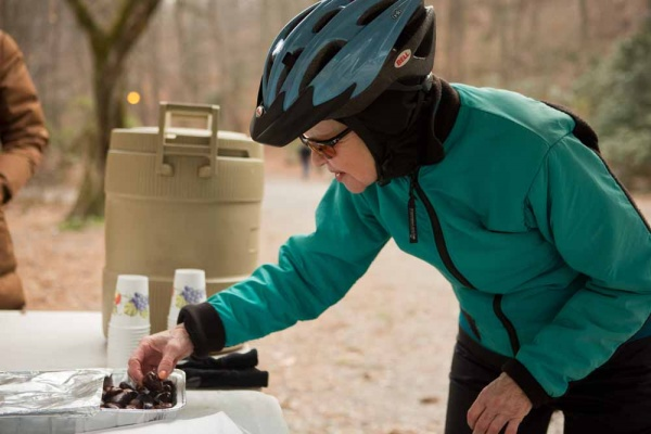 <p><p>Alice Clark of Center City tries out some fire-roasted chestnuts at the Winter in the Wissahickon event hosted by the Friends of the Wissahickon. (Dave Tavani/for NewsWorks)</p></p>