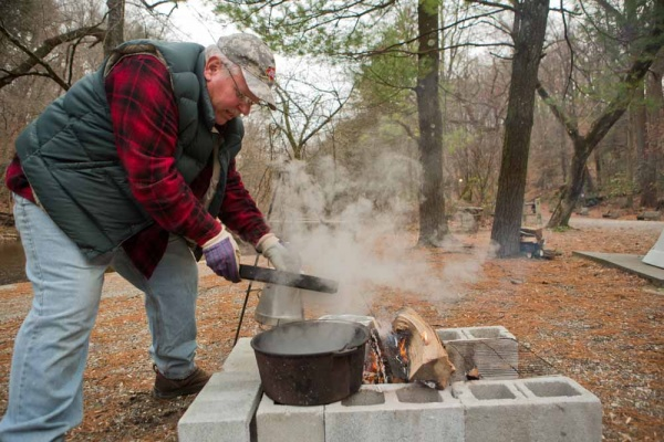 <p><p>Fairmount Park maintainence worker and FOW volunteer Steve Okula checks on the roasting chestnuts at the Winter in the Wissahickon event. (Dave Tavani/for NewsWorks)</p></p>
