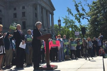 Members of Fair Districts PA, which advocates for redistricting reform, rally on the Capitol steps. (Katie Meyer/WITF)