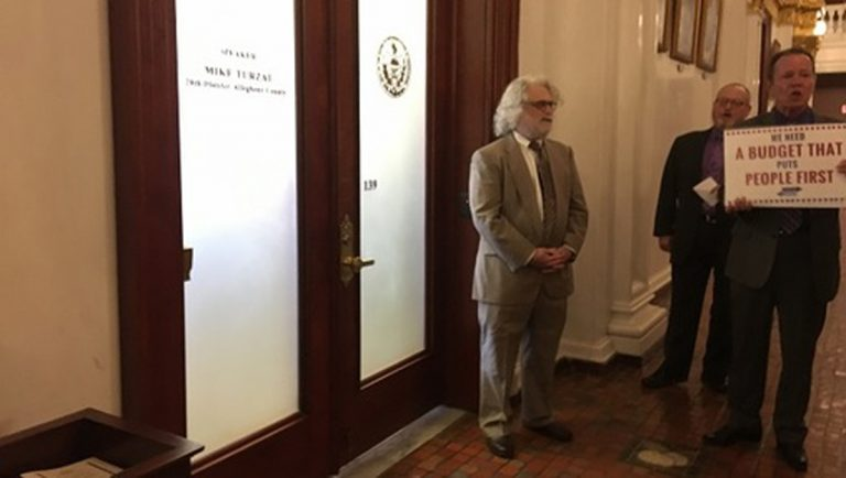 Protesters chant outside Pennsylvania House Speaker Mike Turzai's office door. (Katie Meyer/WITF)