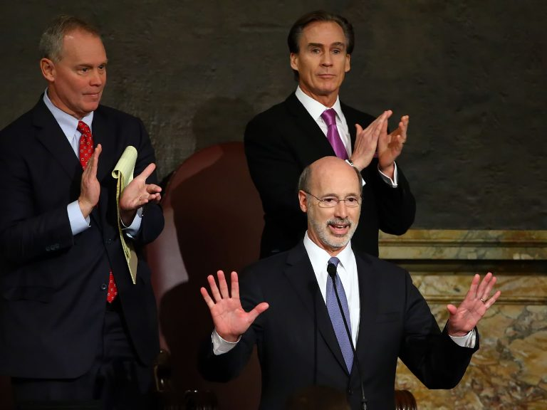 Gov. Tom Wolf, center, delivers his budget address for the 2016-17 fiscal year to a joint session of the Pennsylvania House and Senate, as the speaker of the state House of Representatives, state Rep. Mike Turzai, R-Allegheny, left, and Lt. Gov. Mike Stack, right, listen and applaud at the State Capitol in Harrisburg Pa., Tuesday, Feb. 9, 2016. (AP Photo/Chris Knight)