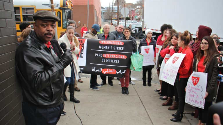 Philadelphia Federation of Teachers President Jerry Jordan (left) speaks to a gathering outside Henry A. Brown Elementary School in Kensington. The group used International Women's Day to highlight the fact that 75 percent of PFT members are women and they have been working without a contract for more than three years. (Emma Lee/WHYY)