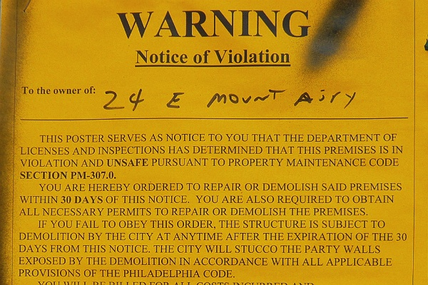 <p><p>Notice of violation posted on the building (Alan Tu/WHYY)</p></p>