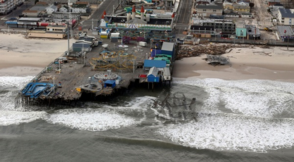 <p>The view of storm damage over the Atlantic Coast in Seaside Heights, N.J.,  Wednesday, Oct. 31, 2012, from a helicopter traveling behind the helicopter carrying President Obama and New Jersey Gov. Chris Christie, as they viewed storm damage from superstorm Sandy.   (AP Photo/Doug Mills, Pool)</p>