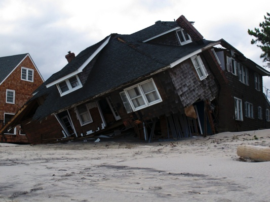 <p>An oceanfront home is destroyed in Mantoloking, N.J., on Oct. 31, 2012. Sandy, the storm that made landfall Monday, caused multiple fatalities, halted mass transit and cut power to more than 6 million homes and businesses. (AP Photo/Wayne Parry)</p>