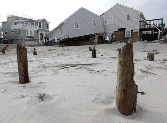 <p>&lt;p&gt;A house that broke from its piers, front, during the storm rests against a neighboring house on Long Beach Island, N.J., Friday, Nov. 2, 2012. (AP Photo/Patrick Semansky)&lt;/p&gt;</p>