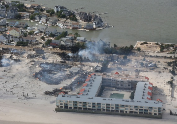 <p>The aerial view shows storm damage over the Atlantic Coast in Seaside Heights, N.J.,  Wednesday, Oct. 31, 2012, taken from a helicopter traveling behind the helicopter carrying President Obama and New Jersey Gov. Chris Christie, as they viewed storm damage from superstorm Sandy.   (AP Photo/Doug Mills, The New York Times, Pool)</p>