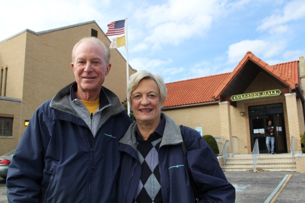 <p>Ocean City residents Peter and Debbie Beck leave St. Francis Cabrini Church after voting. They said the President's handling of the storm didn't affect the way they voted. (Emma Lee/for NewsWorksO</p>