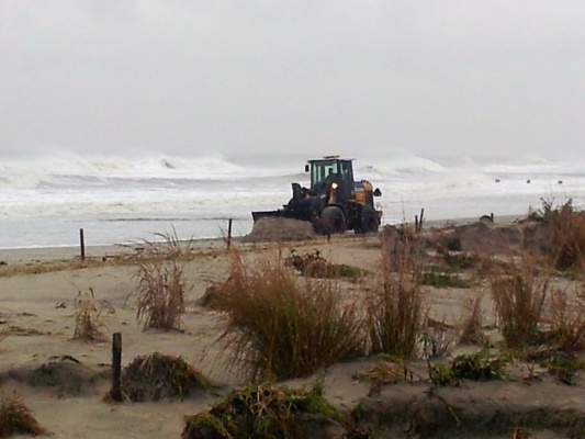 <p>&lt;p&gt;Crews in Ocean City are rushing to build up the dunes before high tide. (Tom Mac Donald/WHYY)&lt;/p&gt;</p>