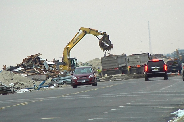 <p><p>Ocean Ave. in Belmar is supposed to be closed to traffic. Clean up crews removing parts of the broken up boardwalk. (Alan Tu/WHYY)</p></p>