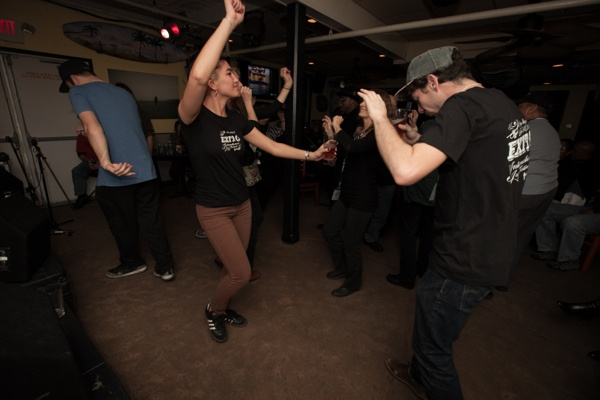 <p>Dancing to brass band music performerd by the Stooges at Cabanas. (Howard Pitkow/for Newsworks)</p>