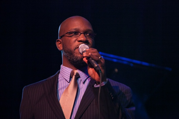 <p>Philadelphia's Orrin Evans introduciong members of his Captain Black Big Band. (Howard Pitkow/for Newsworks)</p>