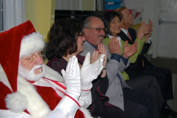 <p>Santa together with the Township Council and Mayor Cahn applaud the talented youth (Natavan Werbock/for NewsWorks)</p>