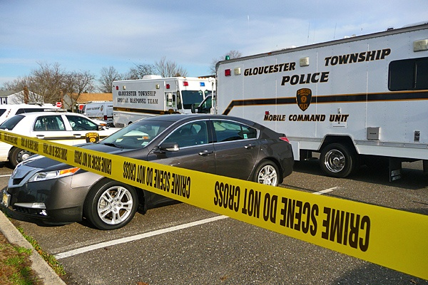 <p><p>Crime scene tape lines the border of the back parking lot of the Gloucester Twp. Police Department. (Alan Tu/WHYY)</p></p>