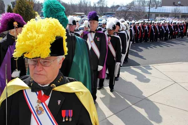 <p>The Knights of Columbus lead the procession that stretches from Our Lady of Hope Parish Center to the doors of St. Agnes Church in Blackwood, where Dennis J. Sullivan was installed as 8th Bishop of Camden. (Emma Lee/for NewsWorks)</p>
