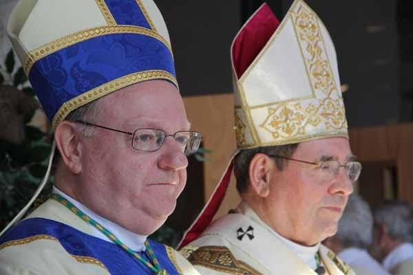 <p>Bishop Dennis J. Sullivan and Archbishop John Myers of Newark watch as the procession files into St. Agnes Church. (Emma Lee/for NewsWorks)</p>