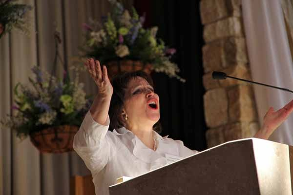 <p>Diana Gambacorta-Rosati sings Psalm 8 prior to the installation mass at St. Agnes Church in Blackwood where Dennis Sullivan became the Bishop of Camden. (Emma Lee/for NewsWorks)</p>