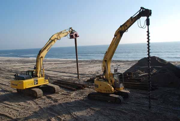 "<p><p><span style=""font-family: Tahoma, 'Sans Serif', Arial; font-size: small;"">A pile driver and auger move down the beach in preparation for installing the first pile. (Sandy Levine/for NewsWorks)</span></p></p>"