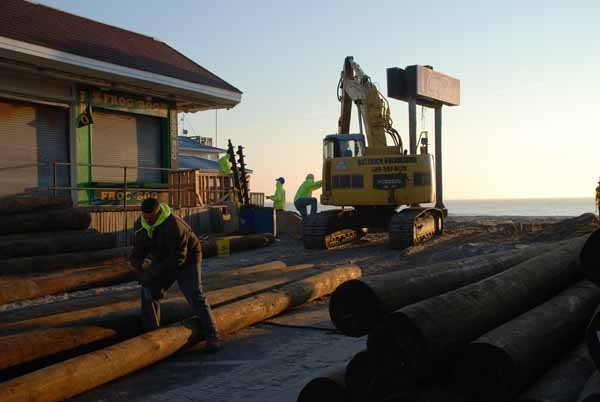 "<p><p><span style=""font-family: Verdana; font-size: small;"">Work crews ready some of the estimated 2000 piles that will support Seaside Heights' new boardwalk. (Sandy Levine/for NewsWorks)</span></p></p>"