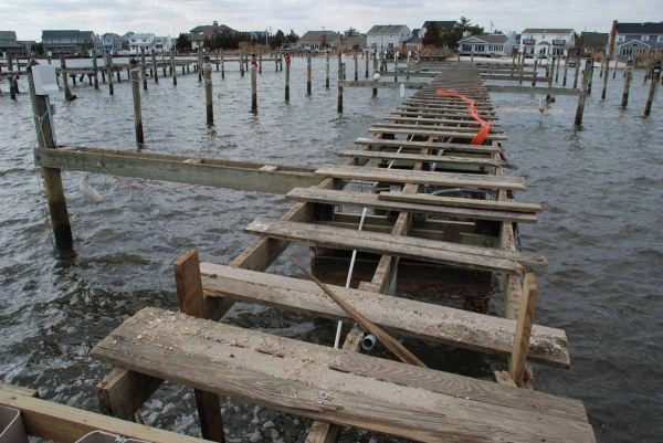 <p>Workers must step gingerly as they restore plumbing and electricity to damaged piers. (Sandy Levine/for NewsWorks)</p>