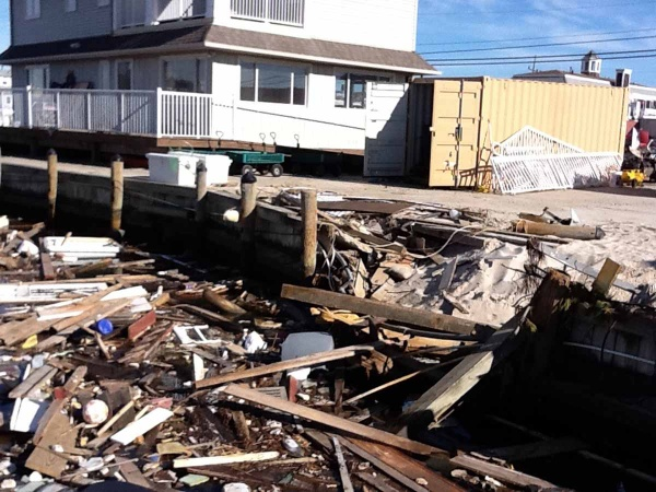 <p><p>As tons of debris washed into the water the marina's bulkhead was damaged. The first floor of the marina office building flooded. (Photo courtesy of Jimmy Ryan)</p></p>
