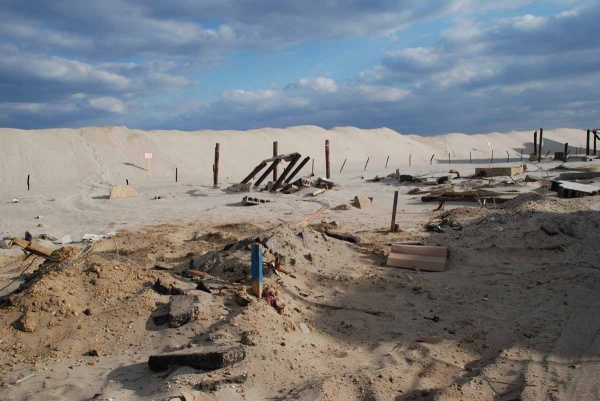 <p>This is all that remains of several oceanfront homes that stood here. During the storm parts of the shattered houses washed across the island into the marina. (Sandy Levine/for NewsWorks)</p>