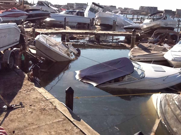 <p><p>After the storm the marina was littered with damaged boats resting on top of debris from oceanfront homes that washed across the island. (Photo courtesy of Jimmy Ryan)</p></p>