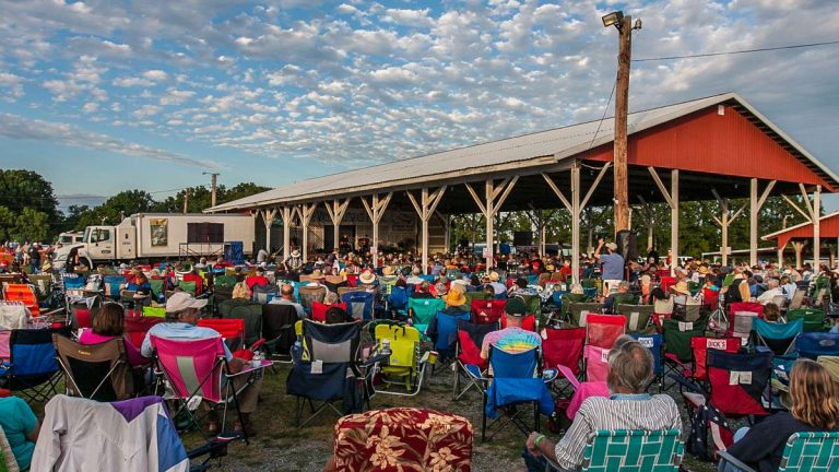 It's a very relaxed atmosphere at the DelVal Bluegrass Festival. You are welcome to sit in any chair until the owner comes back. (Howard Pitkow/for Newsworks, 2016 file photo)