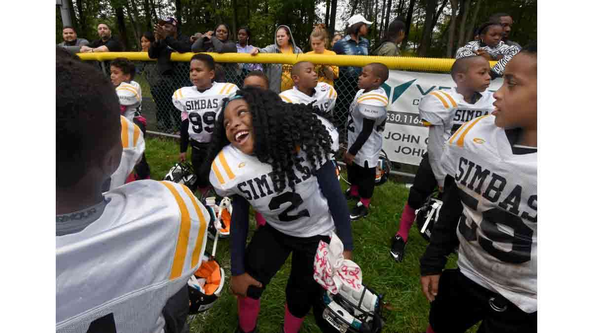 On the sidelines of a Simbas game in Howell, N.J., Janiyah Hill lets down her hair.