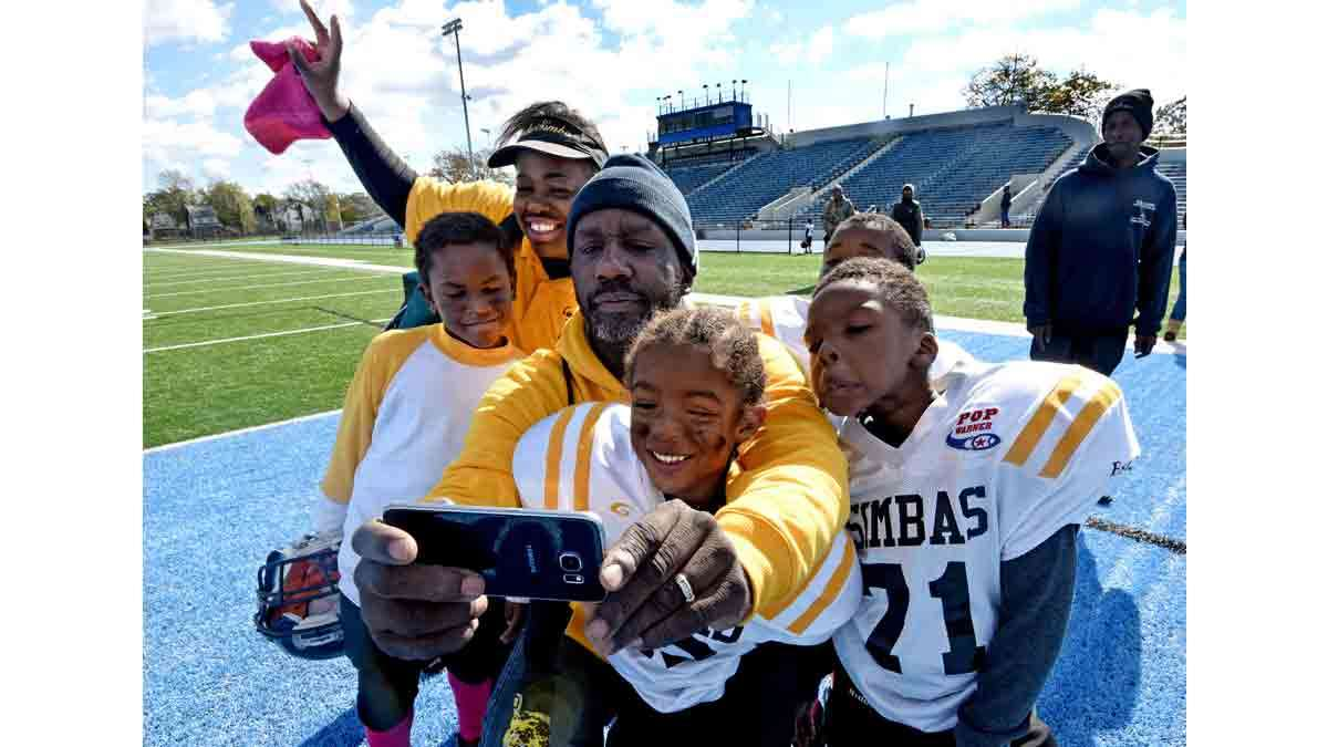After the last game in Asbury Park, coaches Deneen Roundtree and Orlando Council-Pettigrew take a selfie with players from left to right: Caleb Johnson; Ion Townsend; and Timil Moore.