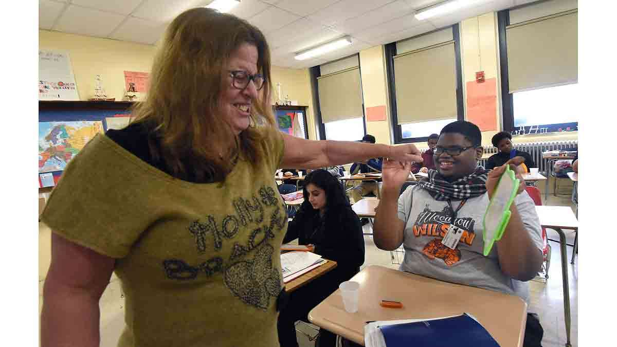 rench teacher Paula Saillard fist-bumps French student Dyrell Mack, 18, in class.